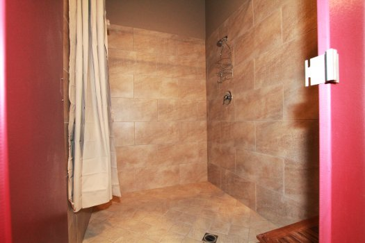 Our Bathrooms Feature Spacious New Tile Showers. No Coins Required!